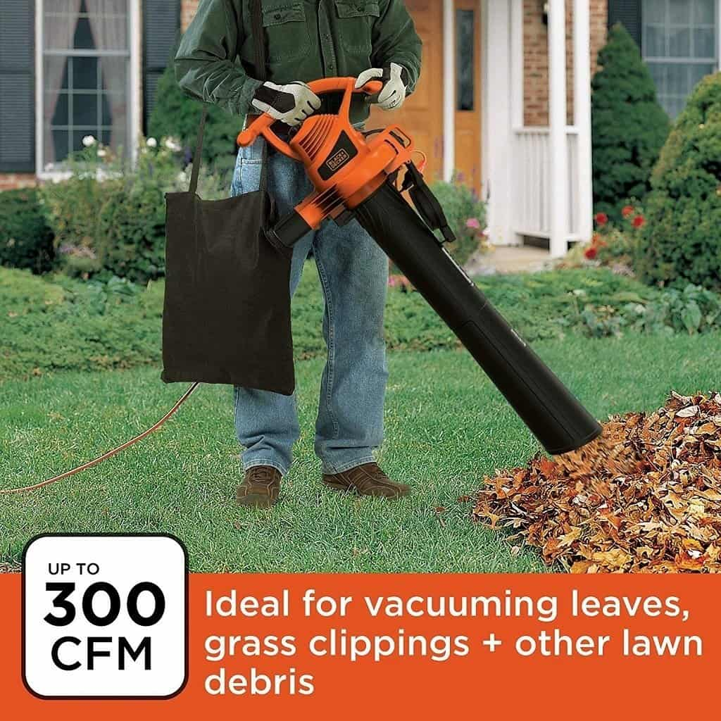 Black & Decker model BV3100 vacuuming up a pile of leaves to make mulch