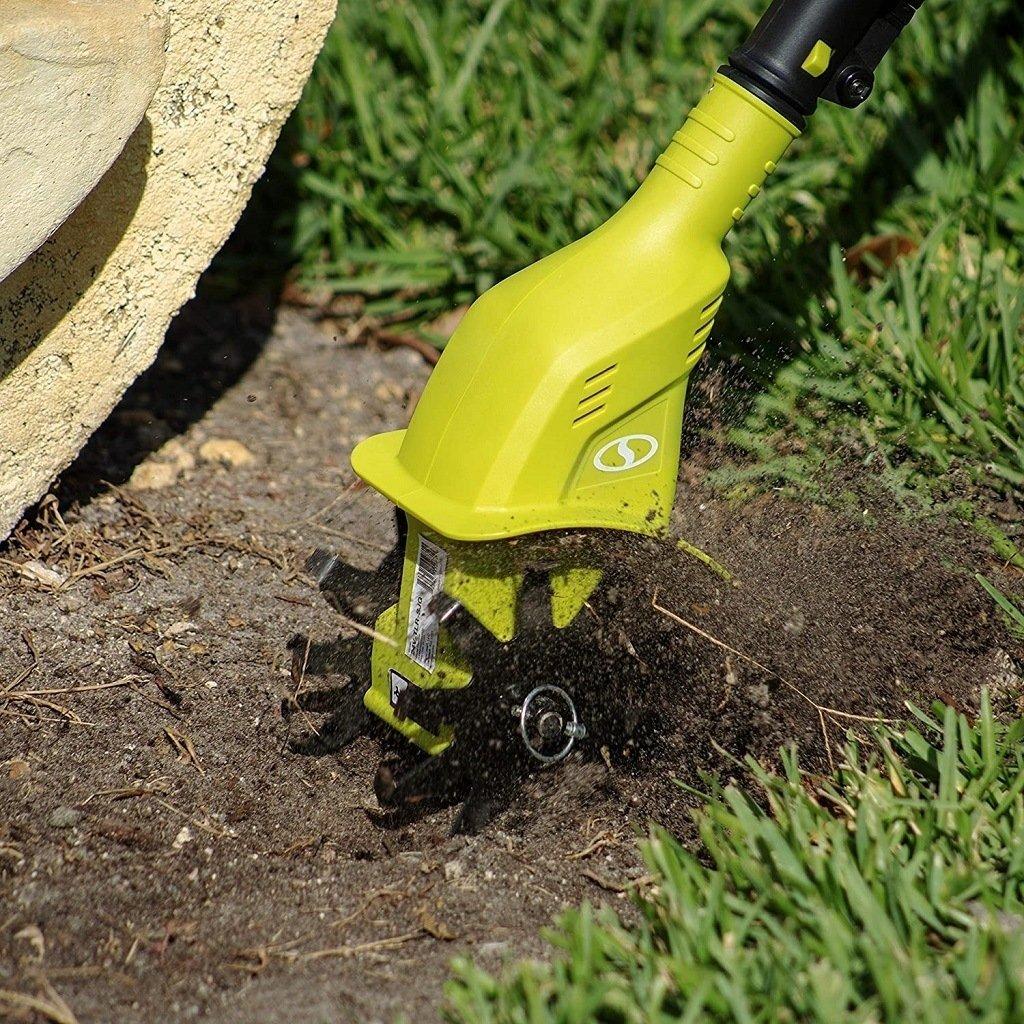 SunJoe lightweight culivator preparing soil for a new garden bed