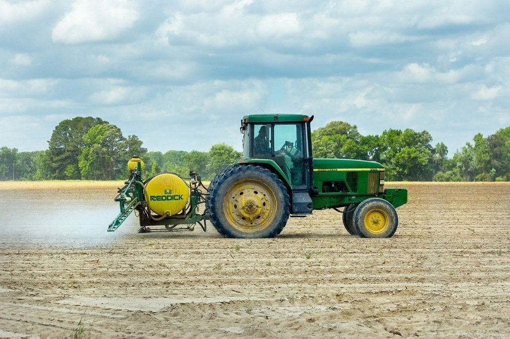 green tractor on the farm