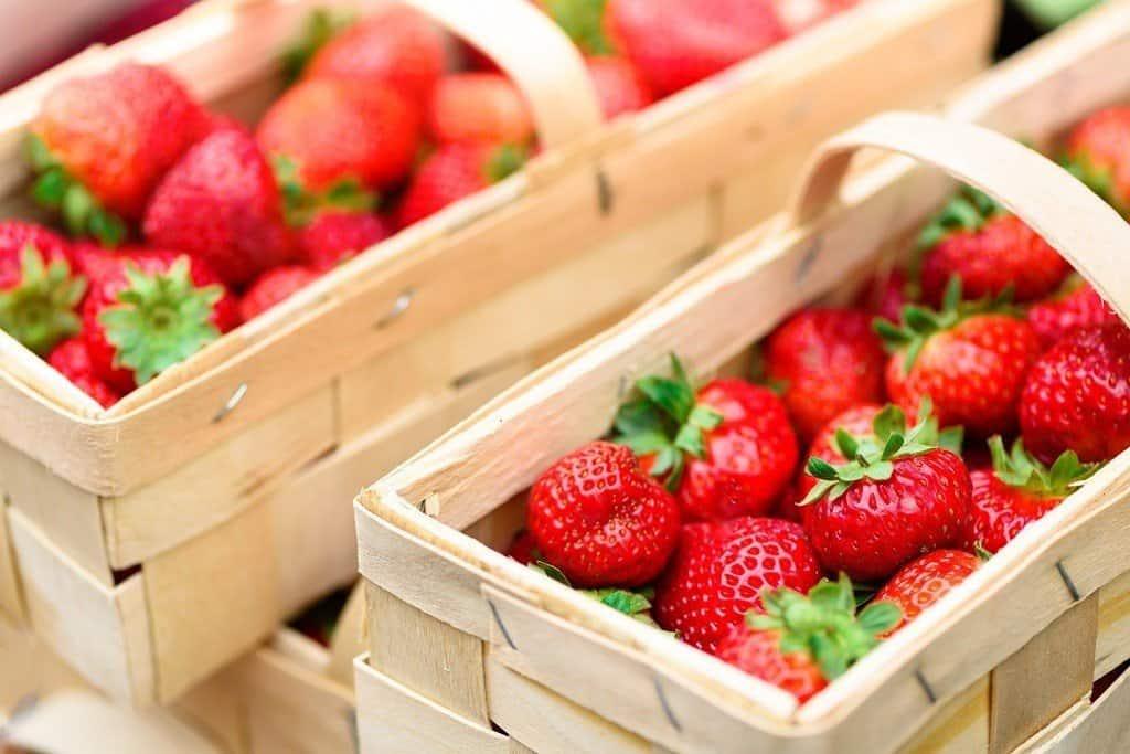 basket of strawberries in wooden basket